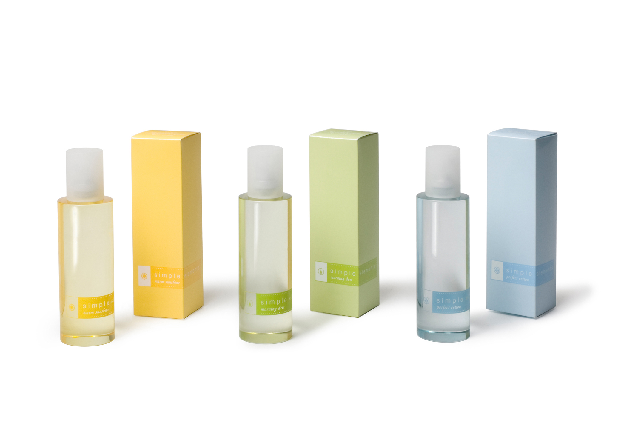 Avon Simple Elements perfume cosmetic packaging design with transparent bottles and pastel yellow, green and blue labels.