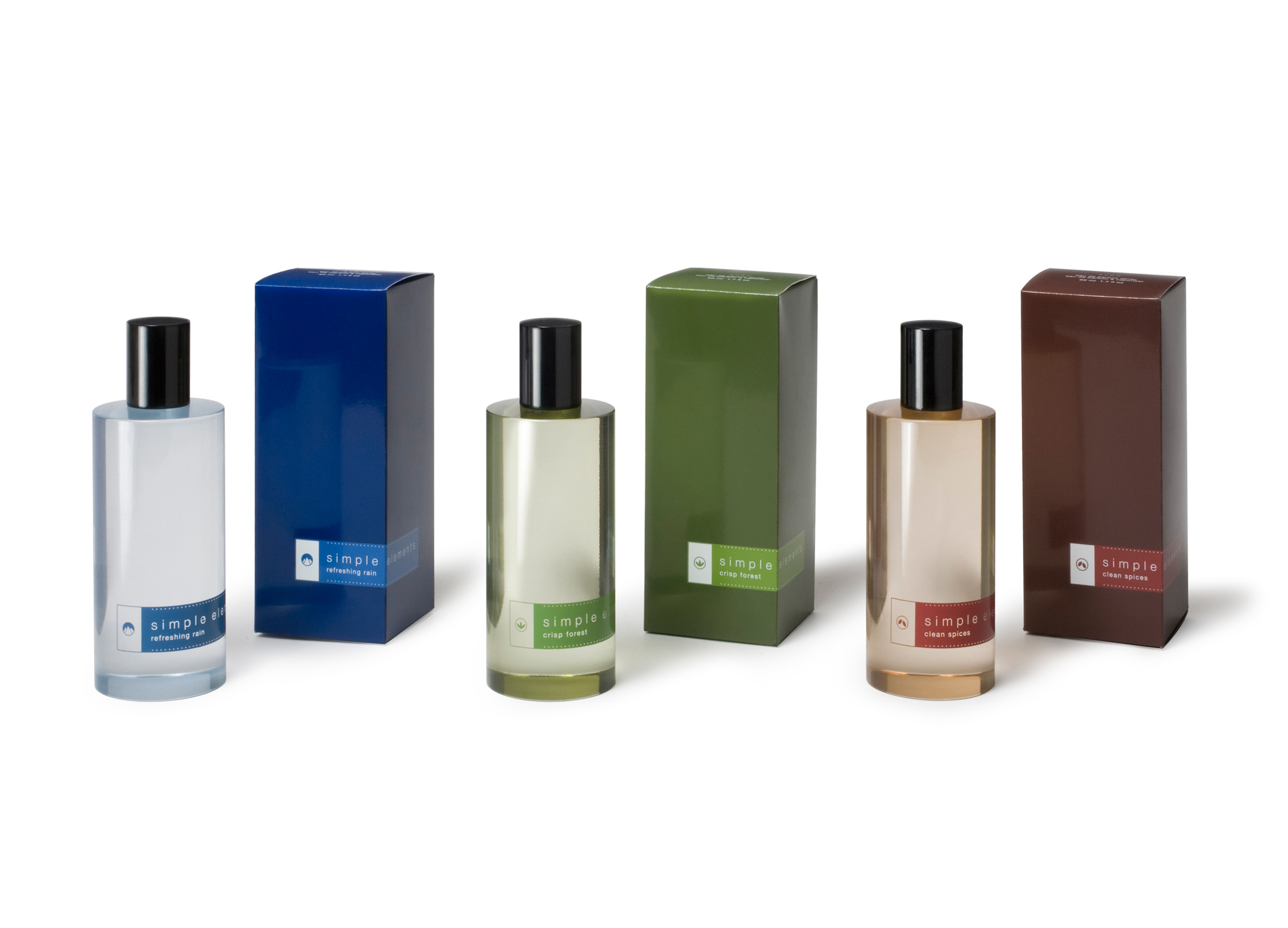 Avon Simple Elements perfume cosmetic packaging design with transparent bottles and dark blue, green and red labels.
