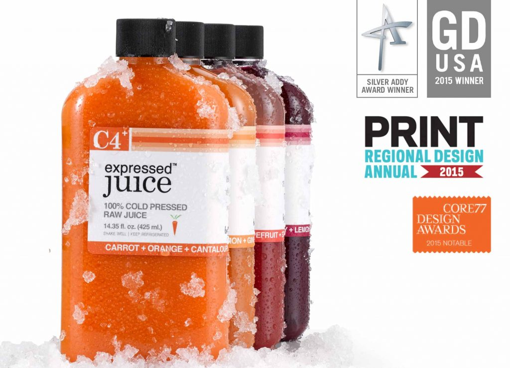 Expressed Juice brand packaging bottles with racing stripe logo alongside icons for the 4 design awards won.
