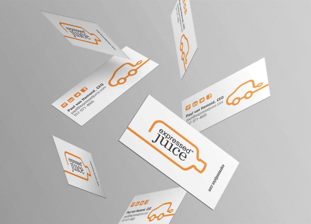 Expressed Juice free falling white business cards in front of grey backdrop with black and orange colored design and font.