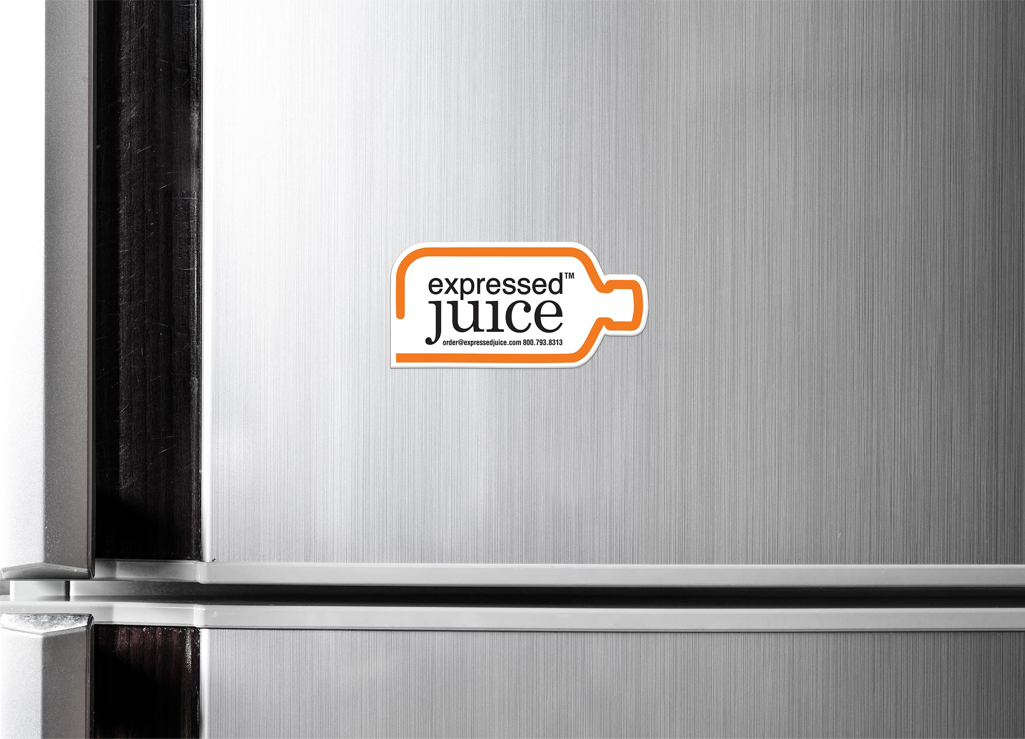 Expressed Juice magnet displayed on stainless steel refrigerator with logo and orange outline of a bottle shape.