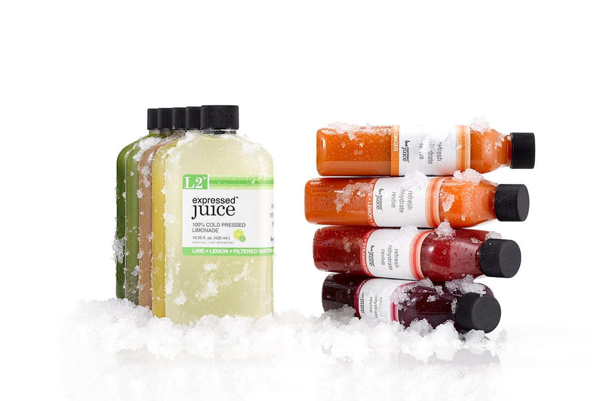 Expressed Juice bottle design showcasing different types of flavors and bottle shapes laying on a layer of crushed ice.