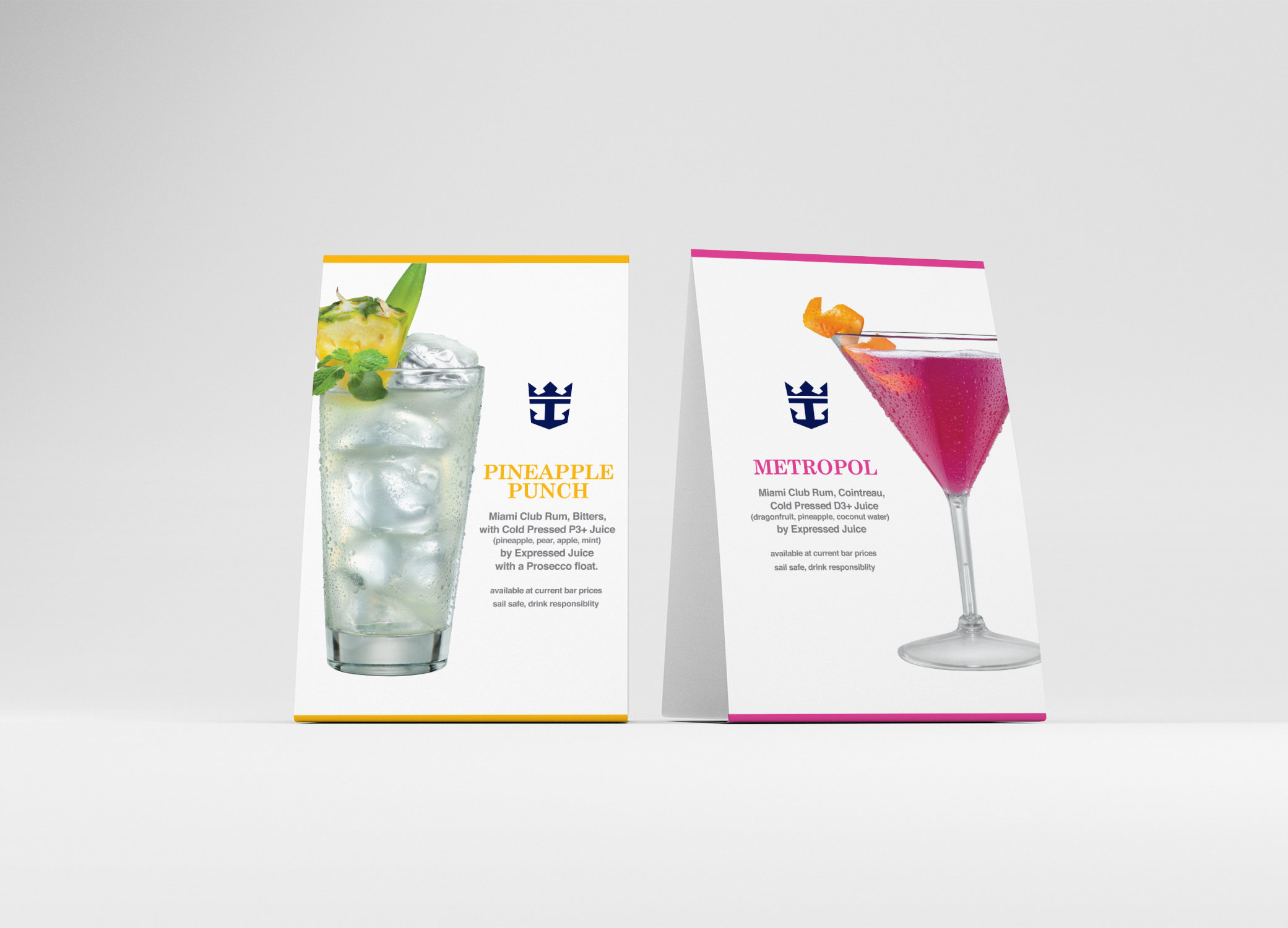 Expressed Juice table talkers promoting Pineapple Punch and Metropol alcoholic beverages against grey backdrop.