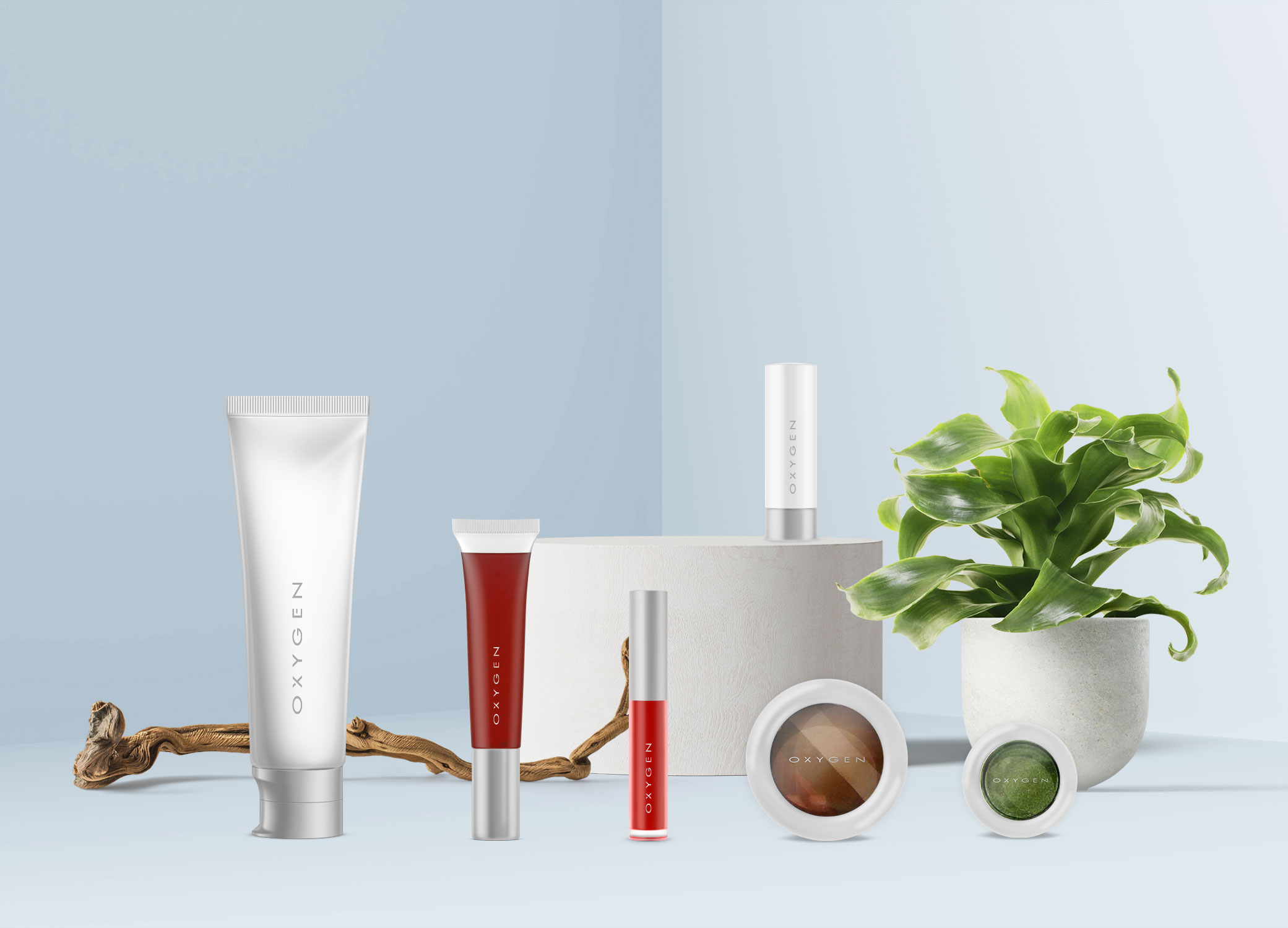 Oxygen package design showing range of makeup and skincare product containers in matte white with silver accents.