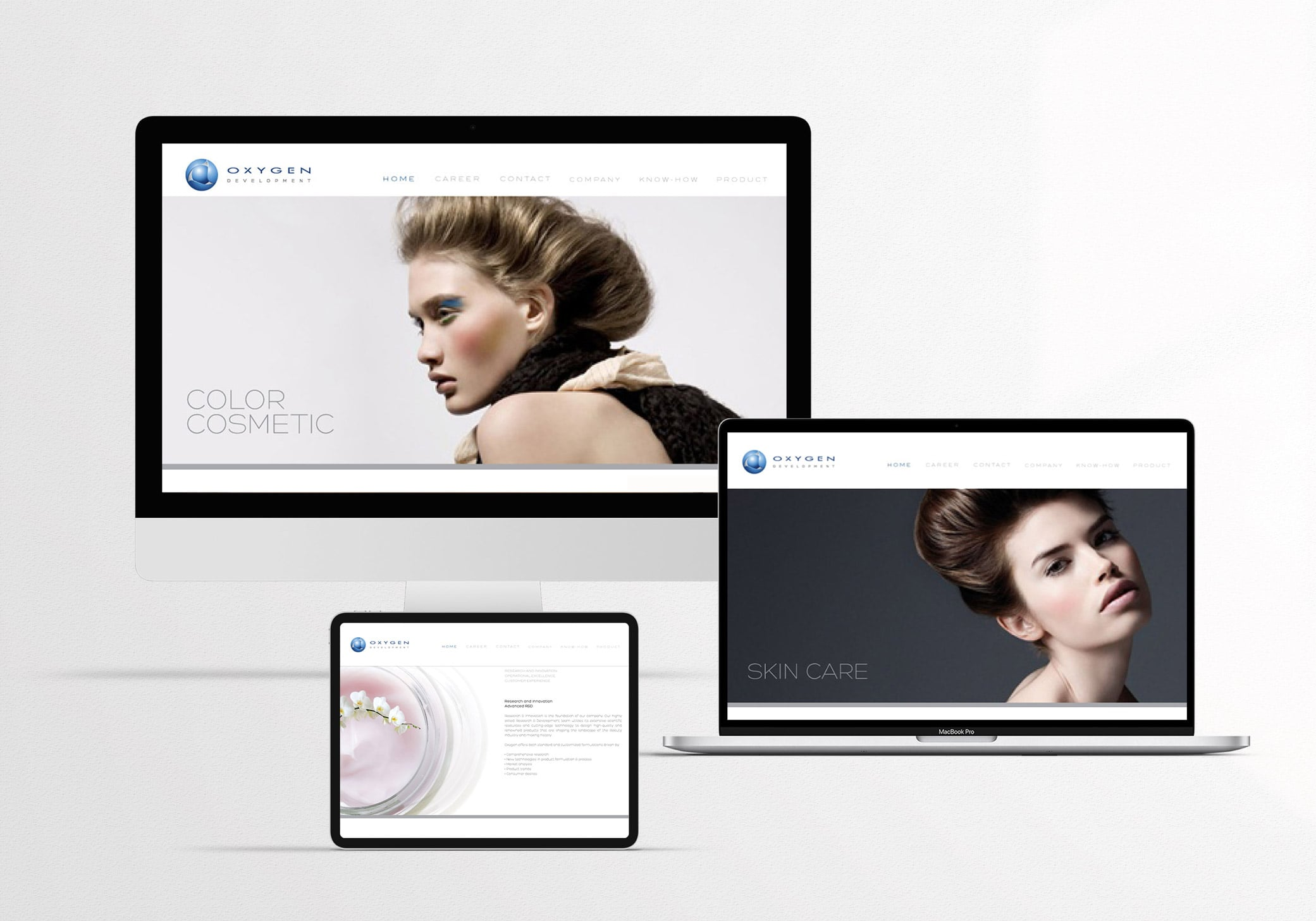 Oxygen premium website design in clean white and neutral tones showing couture makeup products and flawless skincare models.