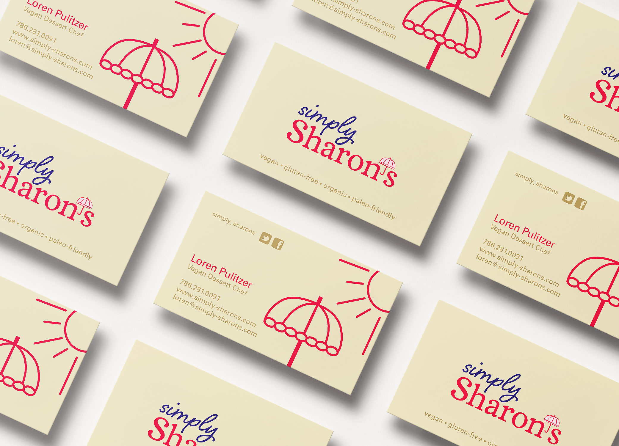 Simply Sharon's business cards in warm beige with red design elements, arranged in diagonal rows to show front and back.