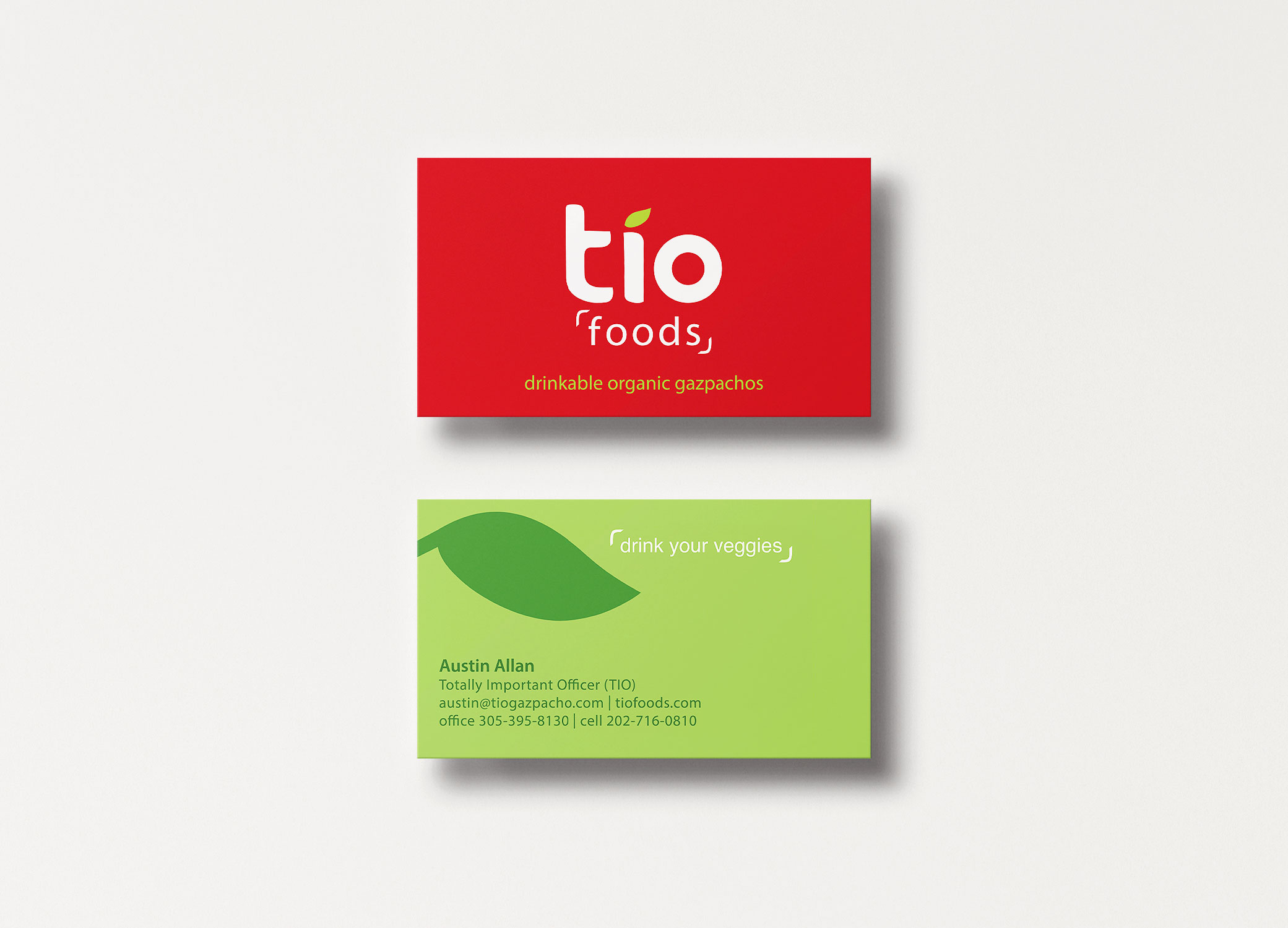 Tio Gazpacho red and green business cards arranged in stacks to show front and back.