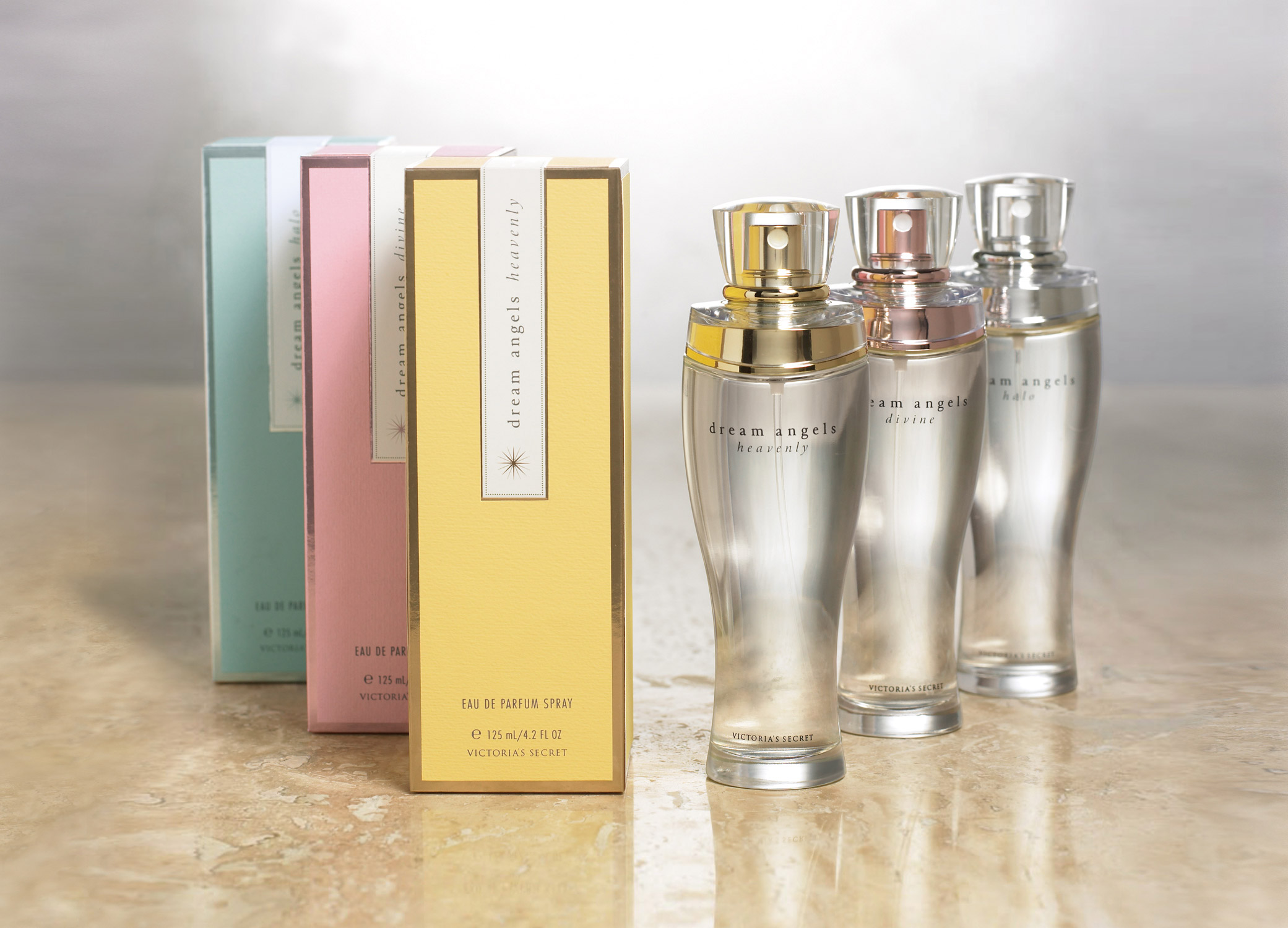 Victoria's Secret Dream Angels packaging design set with fragrance boxes and bottles in pastel colors.