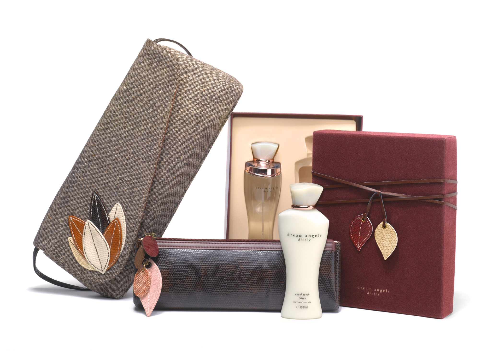 Victoria's Secret Dream Angels Fall promotion gift set with fragrances, boxes, leather pouch, and handbag in earth tones.