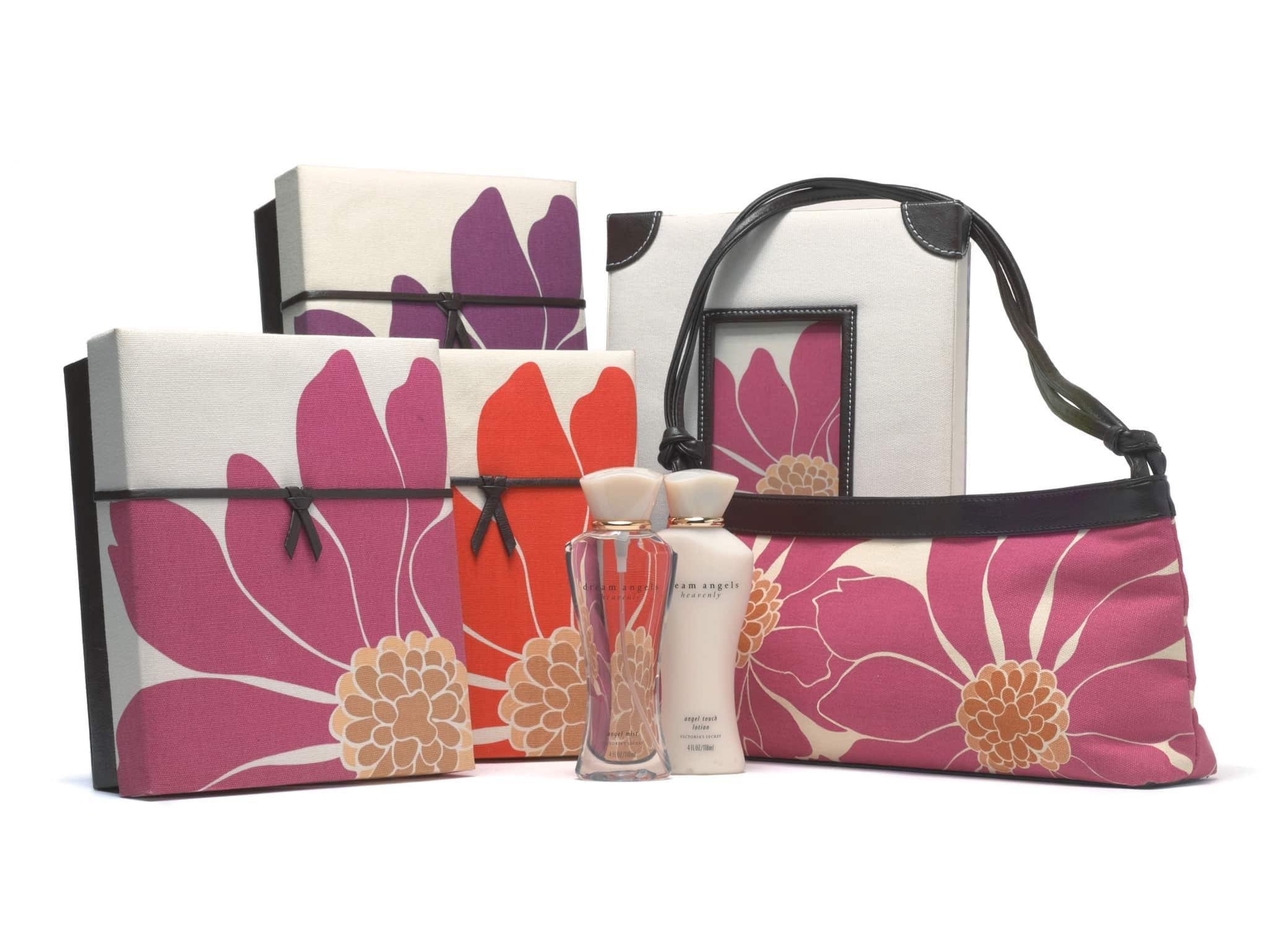 Victoria's Secret Dream Angels gift set design including fragrance bottles, boxes, and handbag with mauvey floral designs.