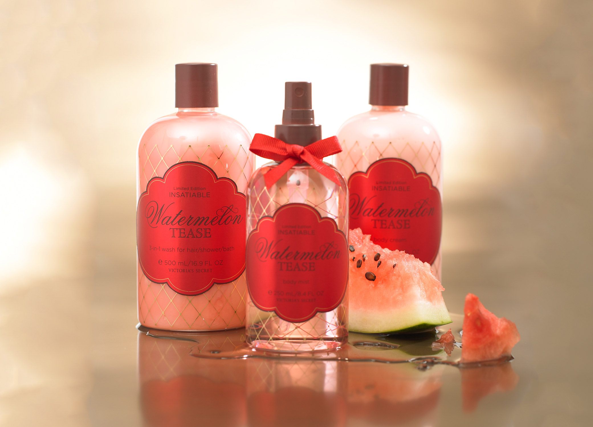 Body spray, wash, and cream packaging design for Victoria's Secret Insatiable. Watermelon Tease line with fishnet stocking pattern and red label.
