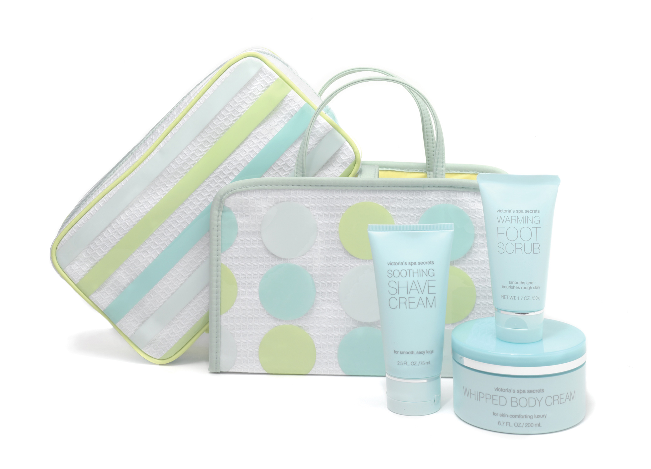 Victoria's Secret Spa Secrets gift bag design with lotions and pouches with bold polka dots and stripes.