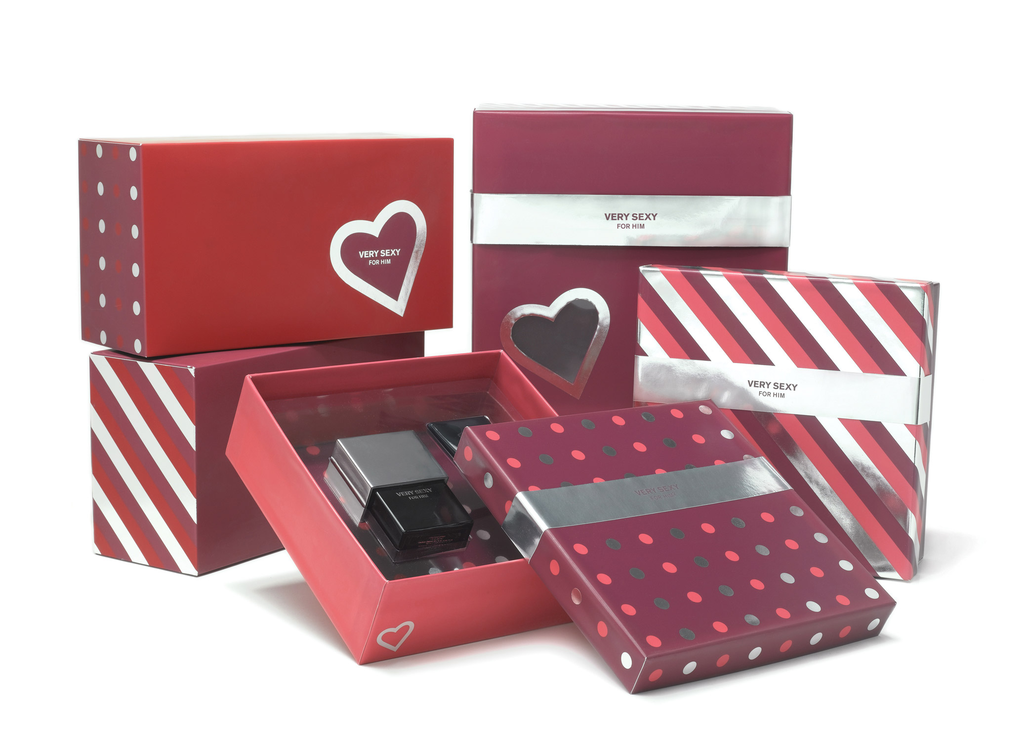 Cosmetic packaging design for Victoria's Secret Very Sexy For Him in silver and red with polka dots, diagonal stripes, and heart icons.