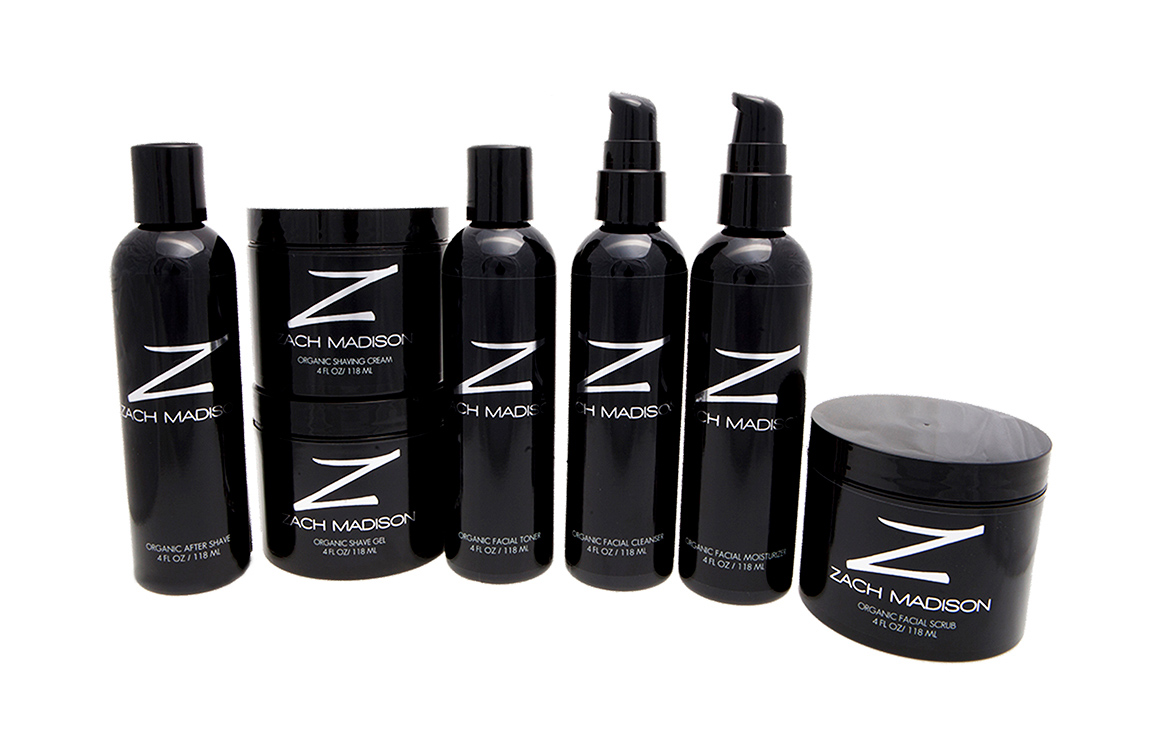 Zach Madison package design showing an array of sleek black bottles with bold silver logo and lettering.
