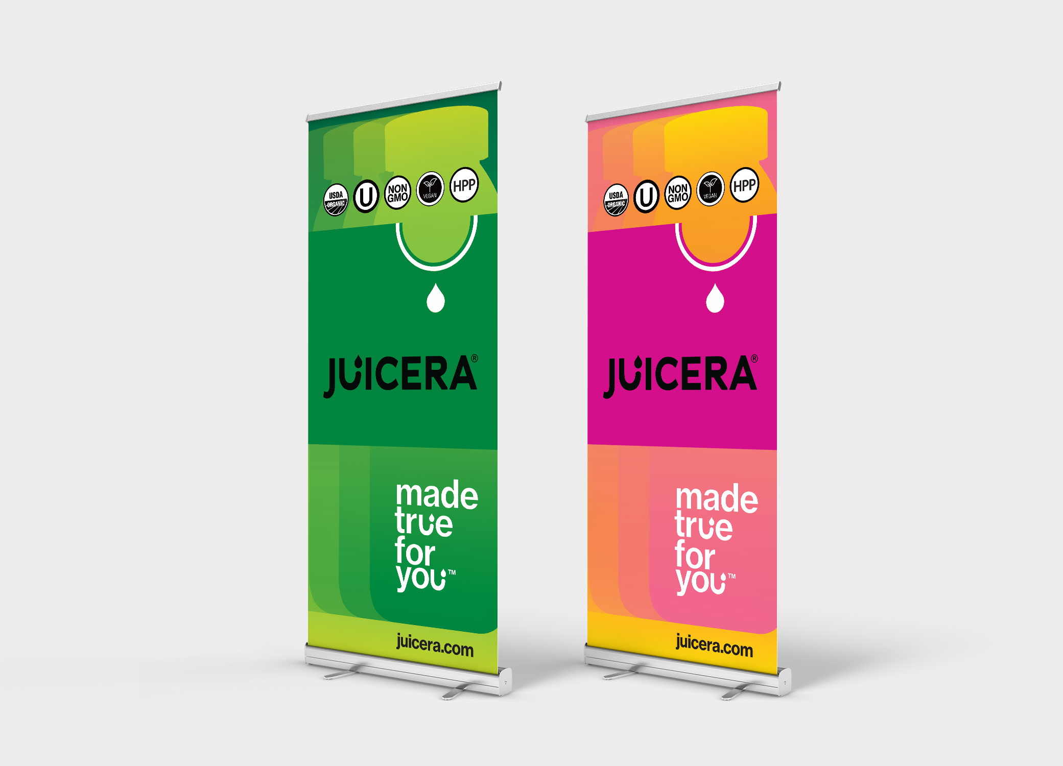Juicera bright pink and green banners arranged next to each other against grey backdrop.