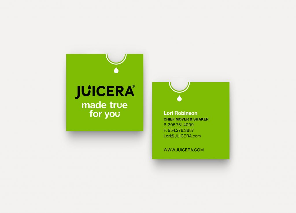 Juicera business cards front and back view in bold green with half-moon die-cut.