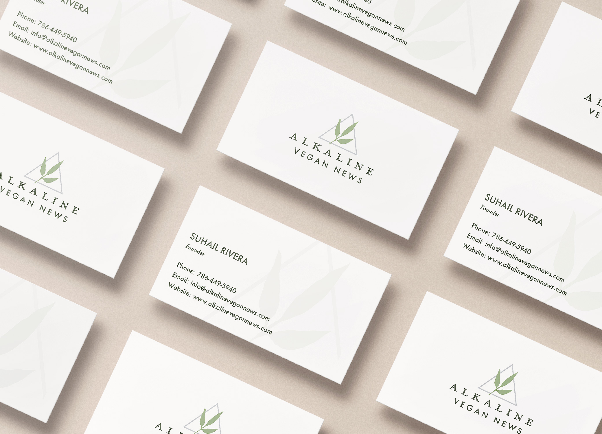 Alkaline Vegan News brand identity showing business card design with leaf logo on the front and watermark on the back.