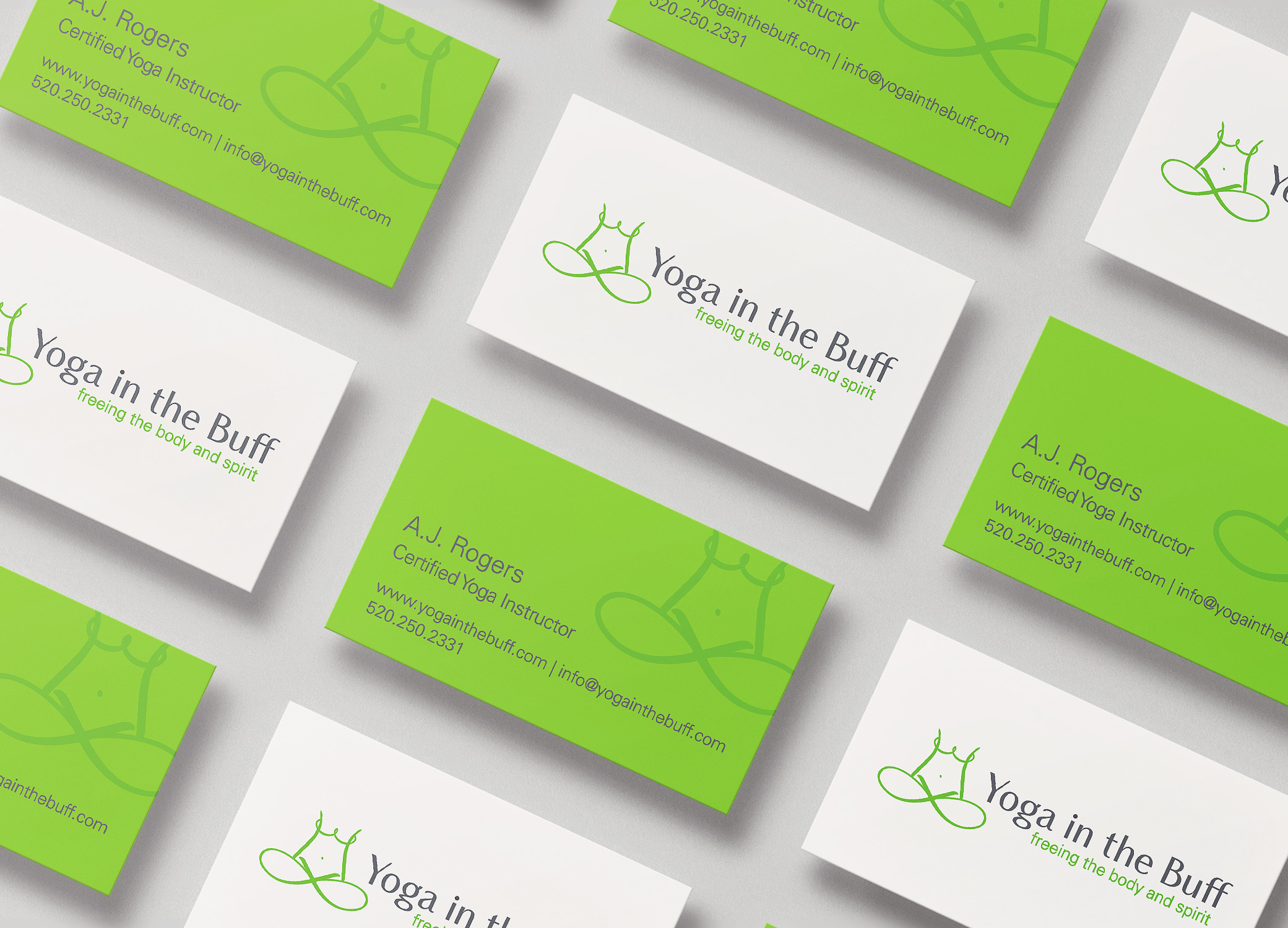 Brand identity for Yoga in the Buff green and white business cards arranged in slanted rows.