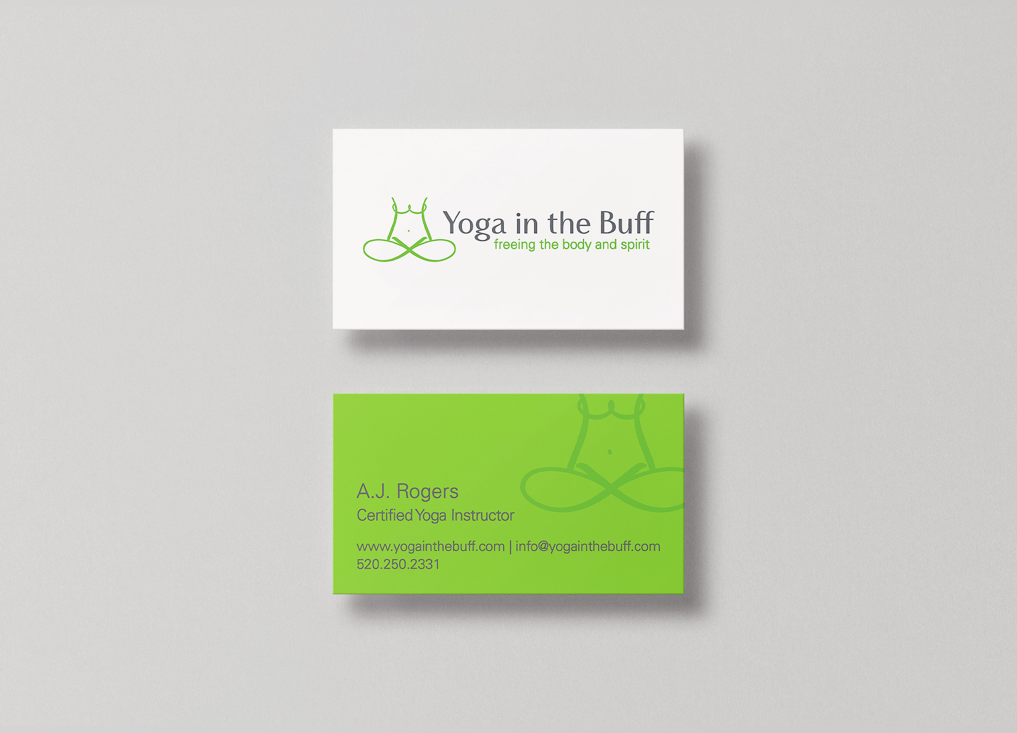 Yoga in the Buff green and white business cards showing front and back with lotus pose design elements.