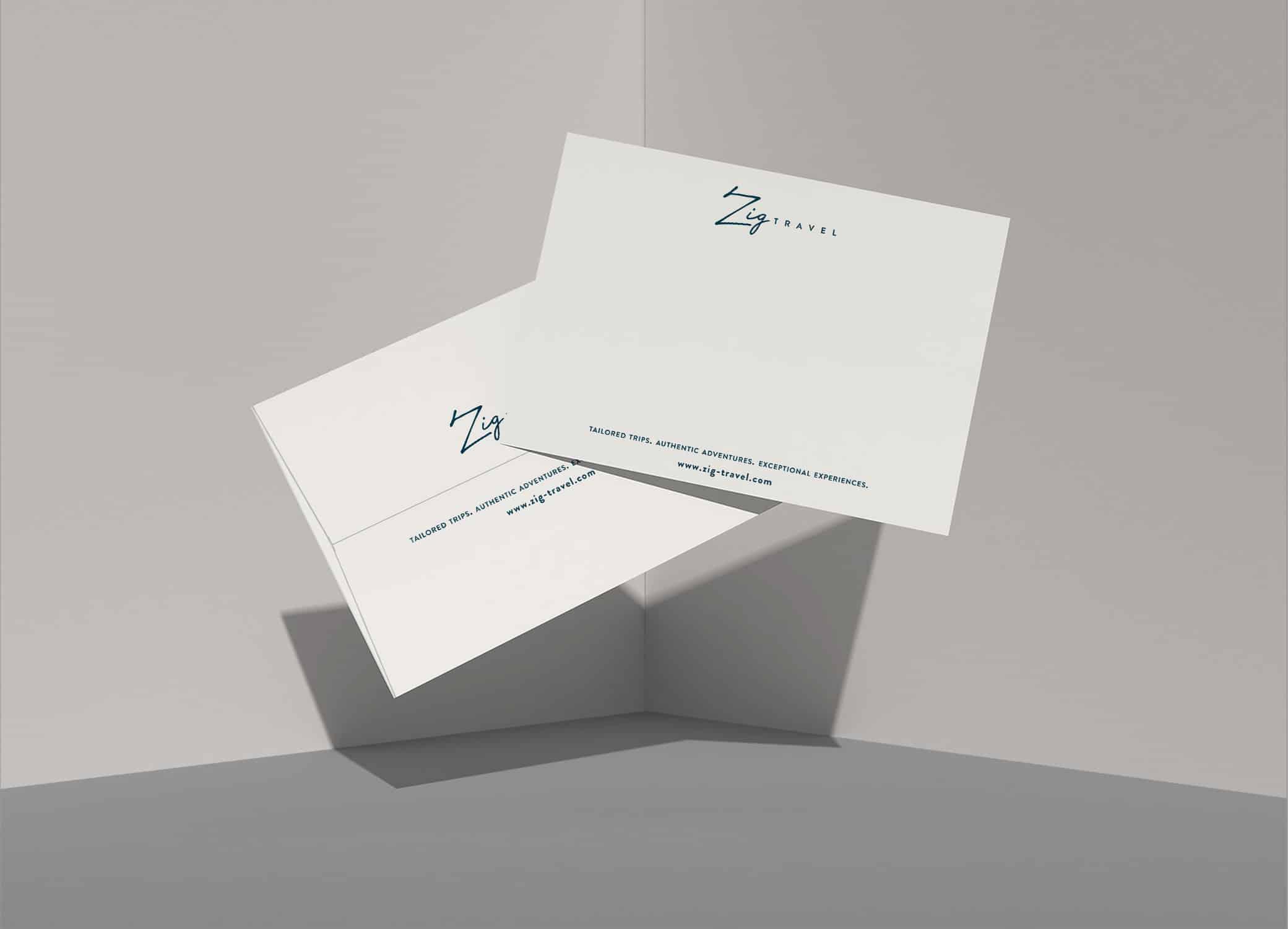 Zig Travel sleek branded note cards in clean white against grey background.