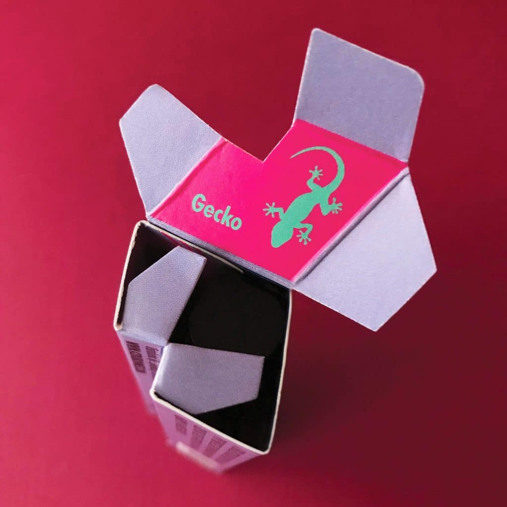42 Dubonnet packaging and makeup brand identity detail showing lipstick box design of gecko icon underneath box top.