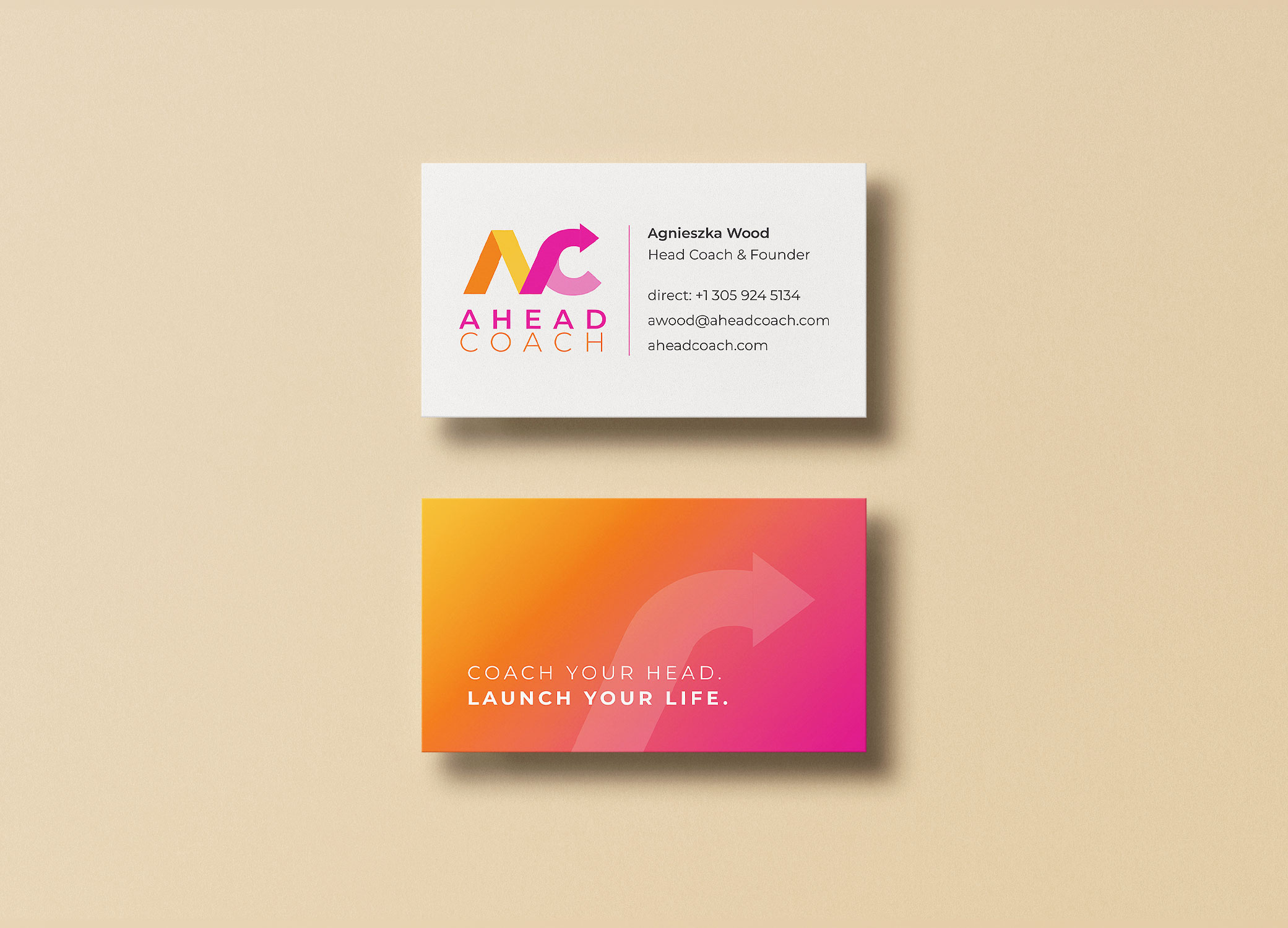 Ahead Coach business cards arranged in 2 stacks showing front and back view.