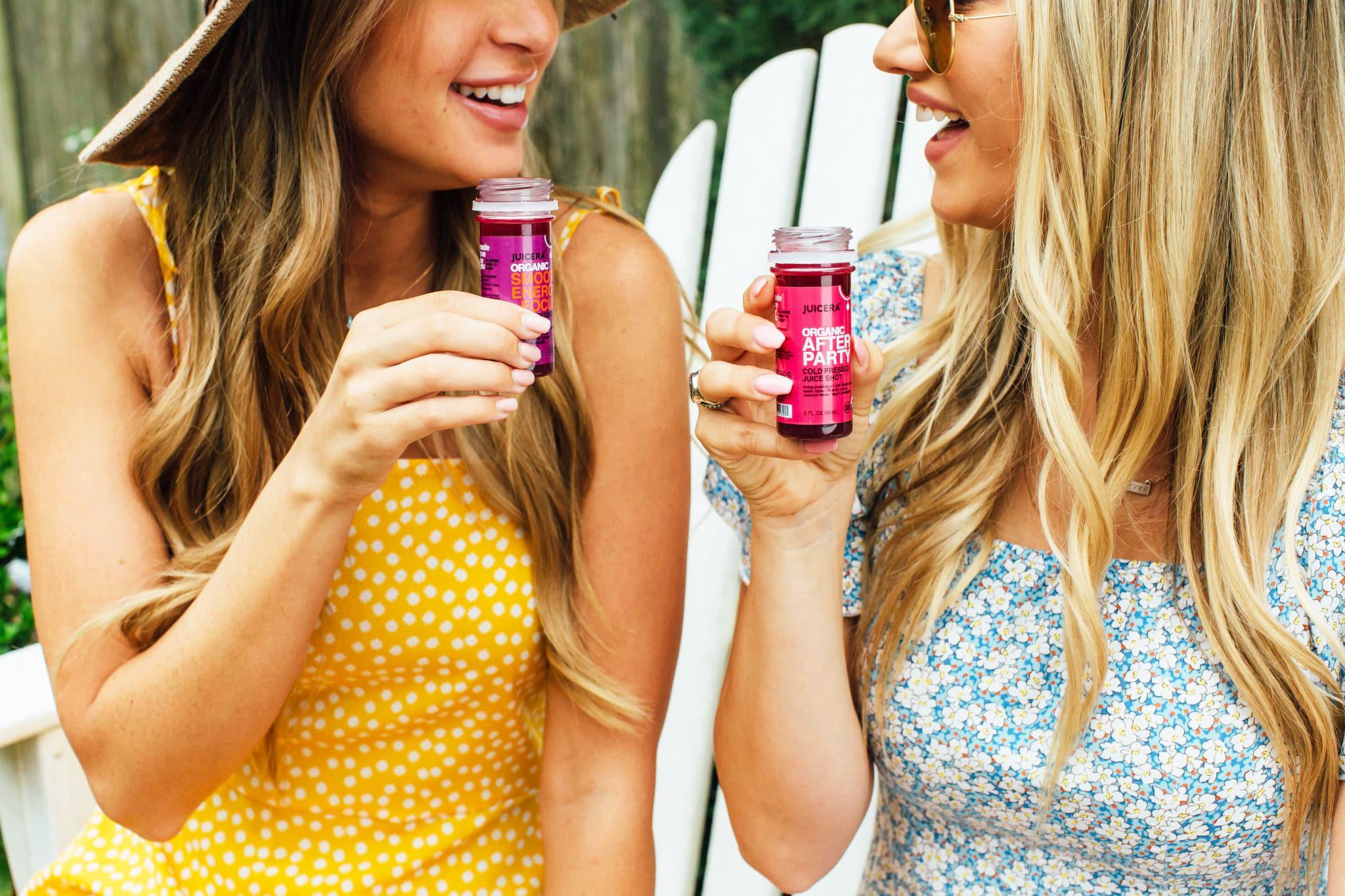 Juicera packaging design showcasing women enjoying juice shots.