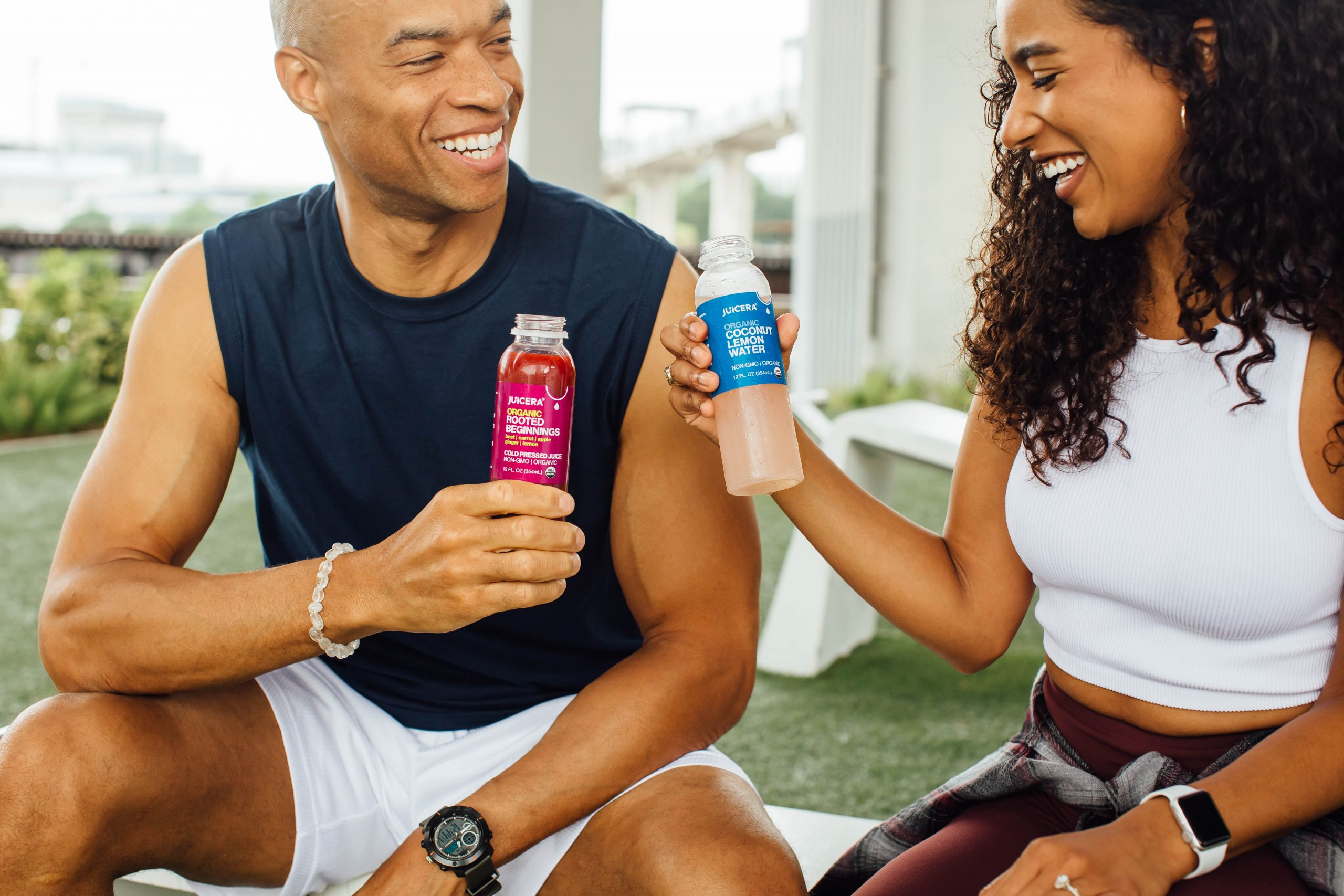 Juicera juice brand product photography of a man and a woman enjoying after a workout.
