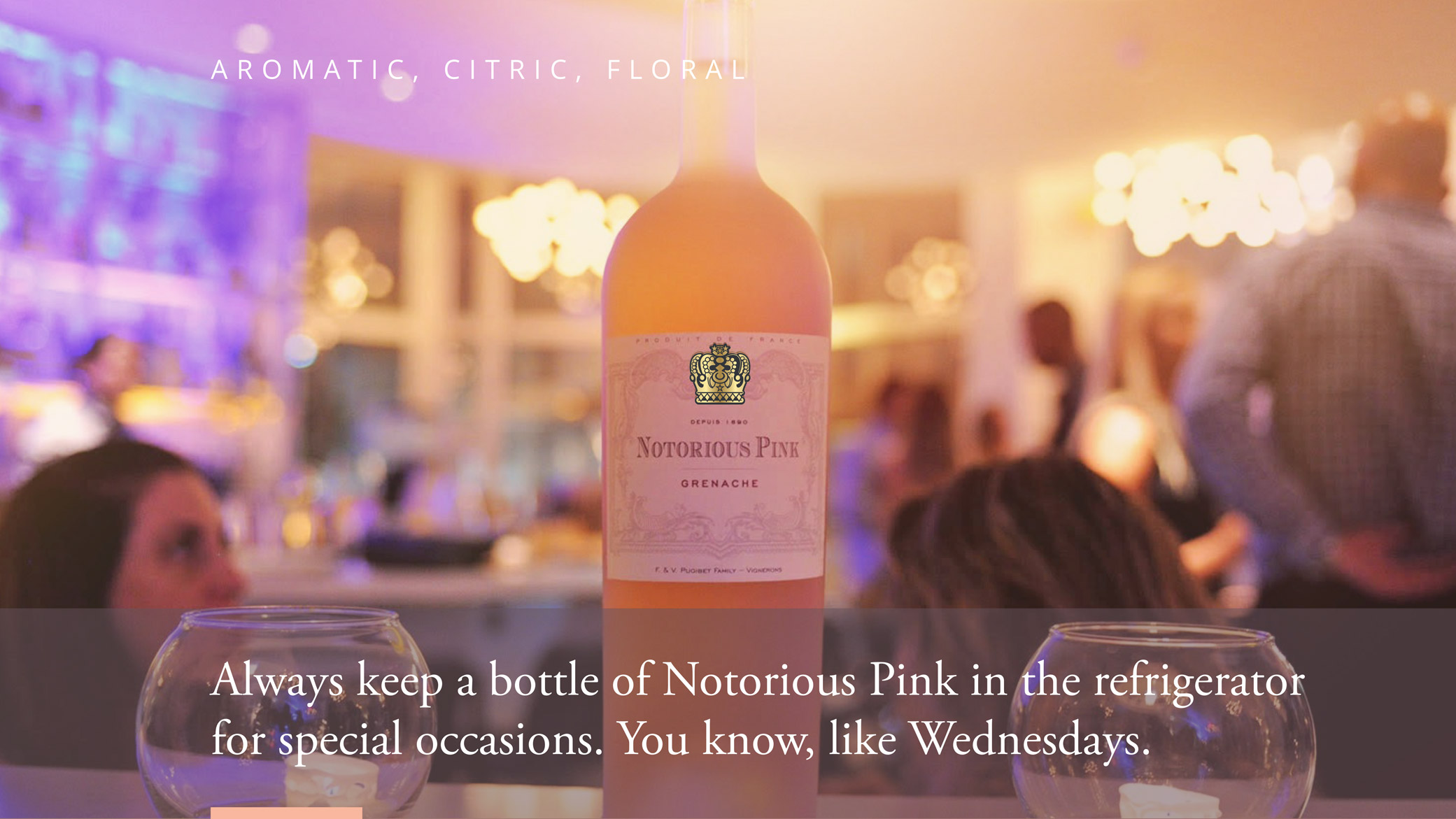 Notorious Pink wine company brand refresh campaign showcasing featured rosé in a dinner setting.