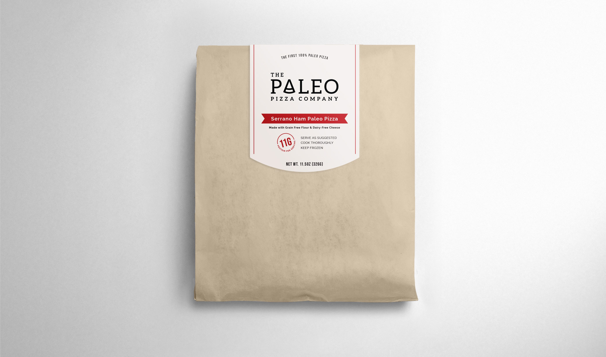 The Paleo Pizza Company packaging design in brown paper bag sealed with sticker label with logo and product description.